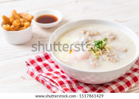 congee with minced pork in bowl - Asian breakfast style #1517861429