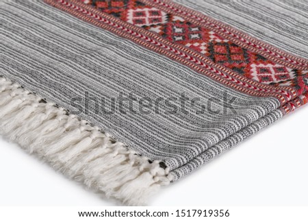 Textile plaid with ornament on wooden background. Colorful plaids, close-up. Homeliness, copy space. #1517919356