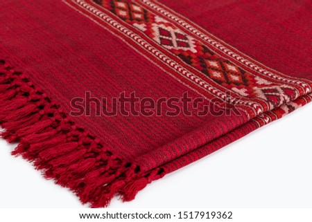 Textile plaid with ornament on wooden background. Colorful plaids, close-up. Homeliness, copy space. #1517919362
