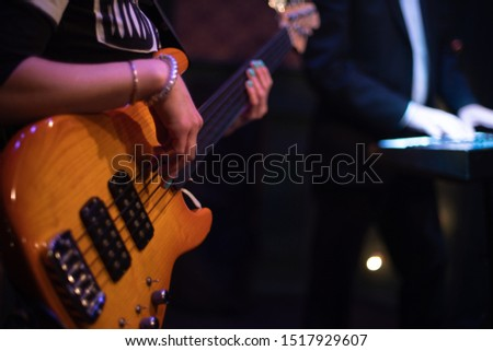 guitar at a concert on stage in the rays of light. #1517929607