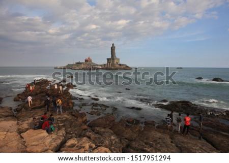 KANYAKUMARI, INDIA - OCT 18 : Unidentified people gathered to take bath in the water at the point where three oceans meet on October 18, 2018 in Kanyakumari, Tamil Nadu, India. #1517951294