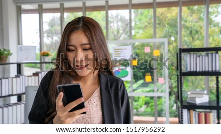 business woman cross one's arm background the confident expression, Asian woman CEO management company of marketing business person working success in the Office indoor , group of work with copy space #1517956292