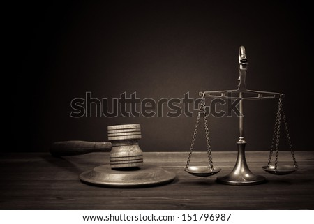 Law scales, judge gavel on table. Symbol of justice. Vintage photo