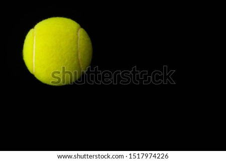 yellow tennis ball on a black background #1517974226