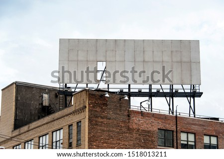 Old building with a worn billboard #1518013211