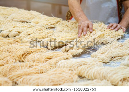 Yellow noodles or Mee Sua food drying in the sunlight Making sun dried in Thailand are Chinese noodle vegetable in vegetarian festival. #1518022763