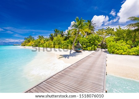 Maldives island beach. Tropical landscape of summer scenery, white sand with palm trees. Luxury travel vacation destination. Exotic beach landscape with swing or hammock. Maldives holiday background #1518076010