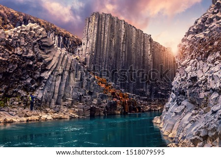 Amazing Nature landscape of Iceland. Impressively beautiful Studlagil canyon with basalt columns and colorful sky during sunset. Tipical Iceland scenery. Iconic location for photographers and bloggers #1518079595