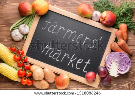 Many healthy vegetables and fruits for farmers' market on wooden background #1518086246