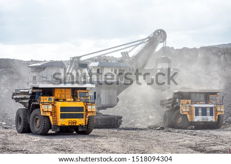 Open mountain quarry. Loading coal into a mining truck. Shipment of mountain masyy from the face. Mining in quarry vehicles. #1518094304