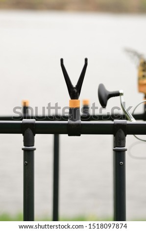 The V-shaped support for a fishing rod on a rod pod #1518097874