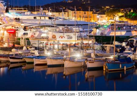 COTE  D'AZUR, FRANCE  , -SEPTEMBER  19, 2019:Boats in the port of Saint Tropez in the evening, Var, Provence-Alpes-Cote d'Azur, France, Europe #1518100730