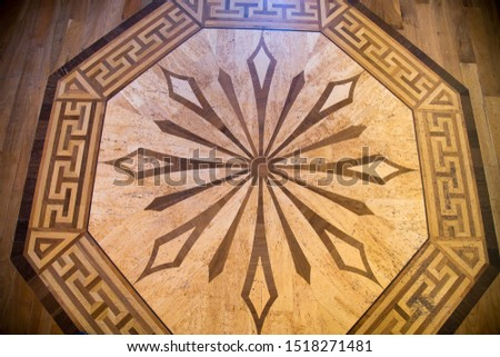 The background of the parquet of different types of wood is a hexagon pattern with radiating rays from the center. Backgrounds Structure Design.
