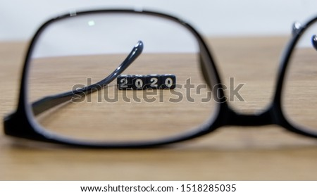 New year concept with glasses in selective focus #1518285035