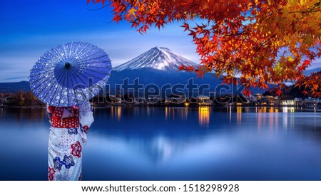 Asian woman wearing japanese traditional kimono at Fuji mountain in autumn, Kawaguchiko lake in Japan. #1518298928