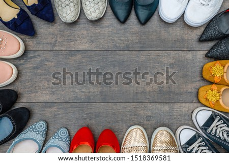 too many shoes on wooden background. Fashion frame of variety women shoes, copy space, text place. Set with different types of women shoes. Fashionable Footwear Set  #1518369581