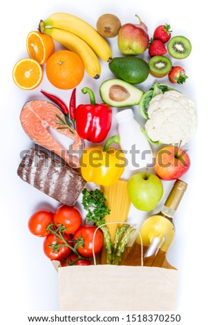 Healthy food background. Healthy food in paper bag fish, pasta, vegetables, fruits and wine on white background. Shopping food supermarket, healthy eating, nutrition plan concept #1518370250