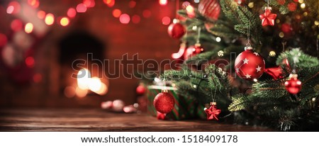 Christmas Tree with Decorations Near a Fireplace with Lights #1518409178
