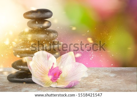 Black stone stack and flower, beautiful Balance concept #1518421547