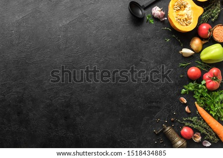 Autumn cooking background with seasonal organic vegetables, herbs on black, top view, copy space. Ingredients for healthy vegetarian vegan seasonal soups and dishes. #1518434885