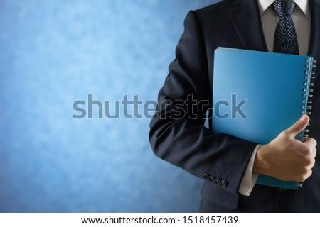 Portrait of happy businessman on background #1518457439