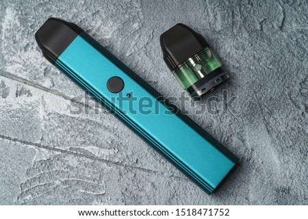Vape pod system or pod mod with changeable cartridges close up - newest generation of vaping products - small size devices for inhaling higher nicotine strengths. #1518471752