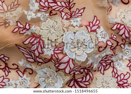 Texture lace fabric. lace on white background studio. thin fabric made of yarn or thread. a background image of ivory-colored lace cloth. Red lace on beige background. #1518496655