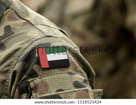 Flag of United Arab Emirates (UAE) on military uniform (collage). Royalty-Free Stock Photo #1518523424