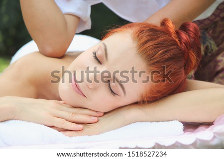 Beautiful women resting relaxing in spa resort with closed eyes. Woman lying down on massage beds outdoor at luxury spa #1518527234