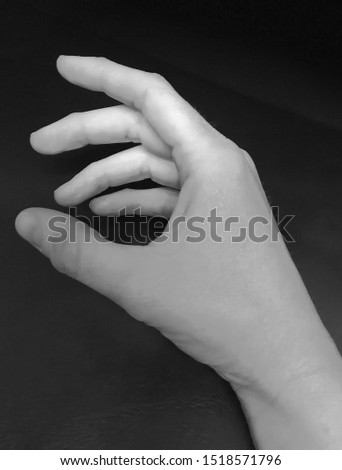 holding on or holding out a hand for someone to hold onto #1518571796