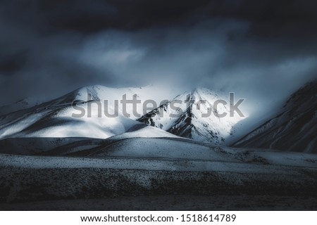 Dark Landscape Mountain Background, Spooky Darkness Winter Storm Weather, Scenic View of Mountains In The Distance, Foggy Misty Clouds Rolling Over Mountain Range #1518614789