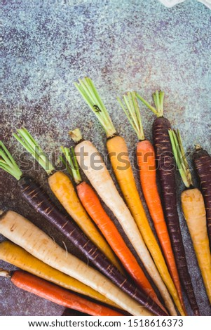 Rainbow Colored Carrots with Tops #1518616373