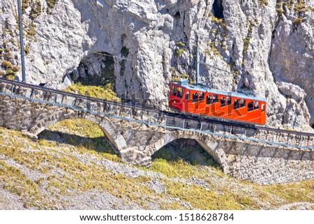 Mount Pilatus ascent on worlds steepest cogwheel railway, 48 percent, tourist landscape of Switzerland #1518628784