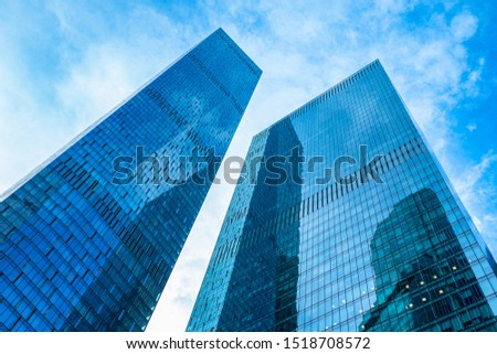 View of skyscrapers from below. Skyscrapers against the blue sky. Tall building. Business center of the city. Modern urban architecture. Houses made of glass and concrete. #1518708572