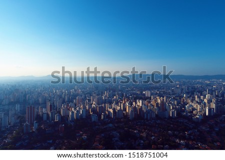 Aerial view of sunset at downtown with a beautiful sky. Fantastic landscape. Skyscrapers in São Paulo, Brazil.  Sunset scene. Aerial landscape and downtown. City life aerial view. #1518751004