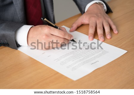 Businessman signing a contract image #1518758564