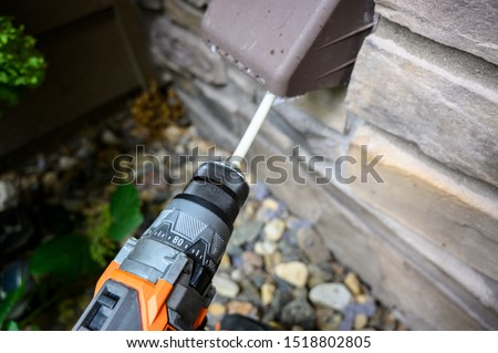 Dryer vent being cleaned with spinning brush #1518802805