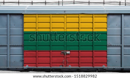 Front view of a container train freight car with a large metal lock with the national flag of Lithuania.The concept of export-import,transportation, national delivery of goods and rail transportation #1518829982