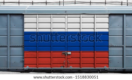 Front view of a container train freight car with a large metal lock with the national flag of Russia.The concept of export-import,transportation, national delivery of goods and rail transportation #1518830051
