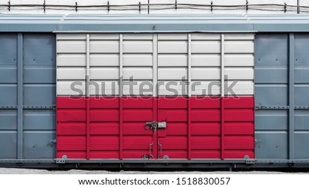 Front view of a container train freight car with a large metal lock with the national flag of Poland.The concept of export-import,transportation, national delivery of goods and rail transportation #1518830057