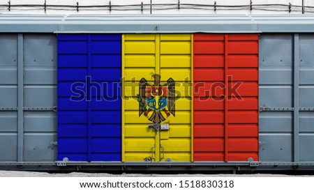Front view of a container train freight car with a large metal lock with the national flag of Moldova.The concept of export-import,transportation, national delivery of goods and rail transportation #1518830318