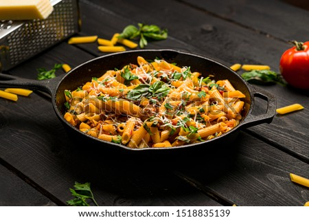 Italian pasta skillet dish. This quick & delicious pasta meal is made with penne pasta, fresh tomato sauce and sausage. This italian inspired comfort food is cooked and served in a cast iron skillet. #1518835139