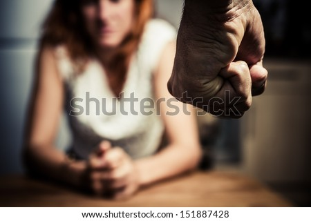 Woman in fear of domestic abuse Royalty-Free Stock Photo #151887428