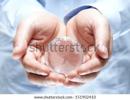 Globe in human hand  isolated on white background #151902410