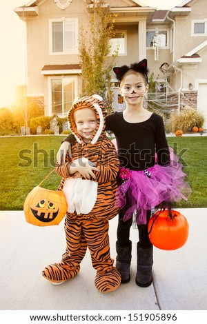 Kids Going Trick or Treating on Halloween #151905896