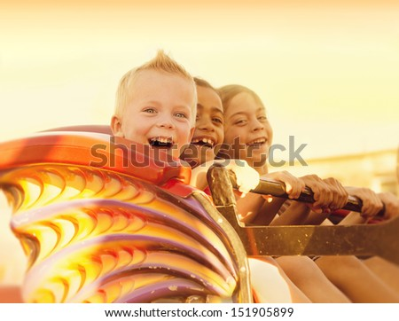 Kids on a Summertime Roller Coaster Ride Royalty-Free Stock Photo #151905899