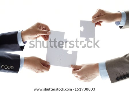 puzzle in hands isolated on white background #151908803