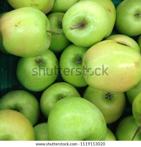 Macro Photo food fruit green apples. Texture background of fresh green apples. Image of fruit product apples grade Golden