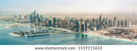 Panoramic aerial view of Dubai Marina skyline with Dubai Eye ferris wheel, United Arab Emirates #1519115633