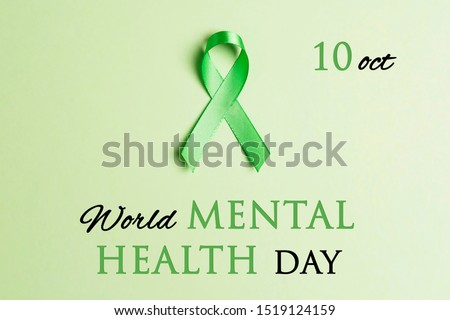 Green awareness ribbon on a green background. World mental health day concept.  #1519124159